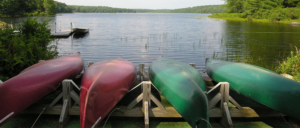 Four canoes in front of Lake Joseph