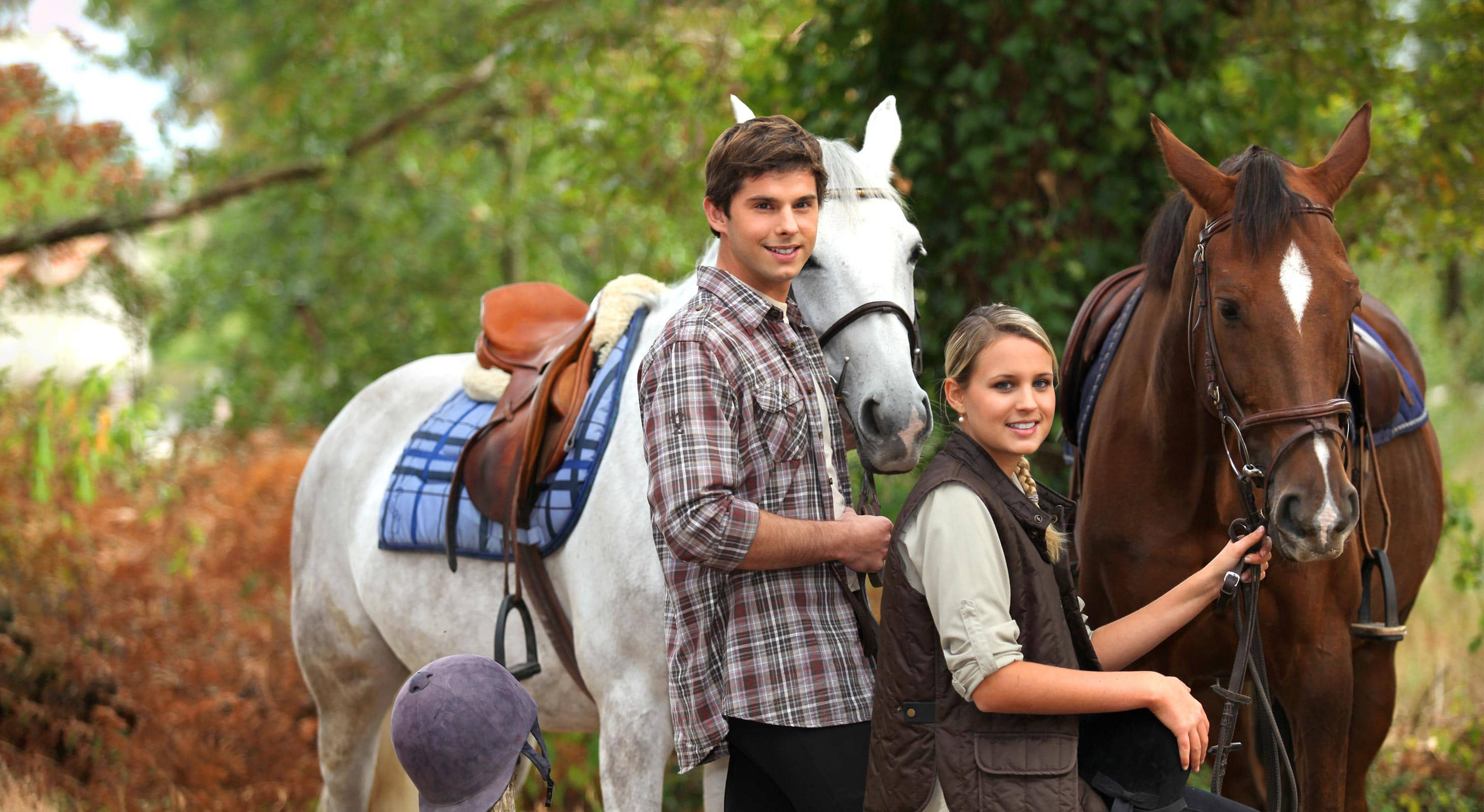 Young Couple preparing for Horseback Riding