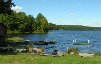 Lounge chairs and docked rowboats on the lake