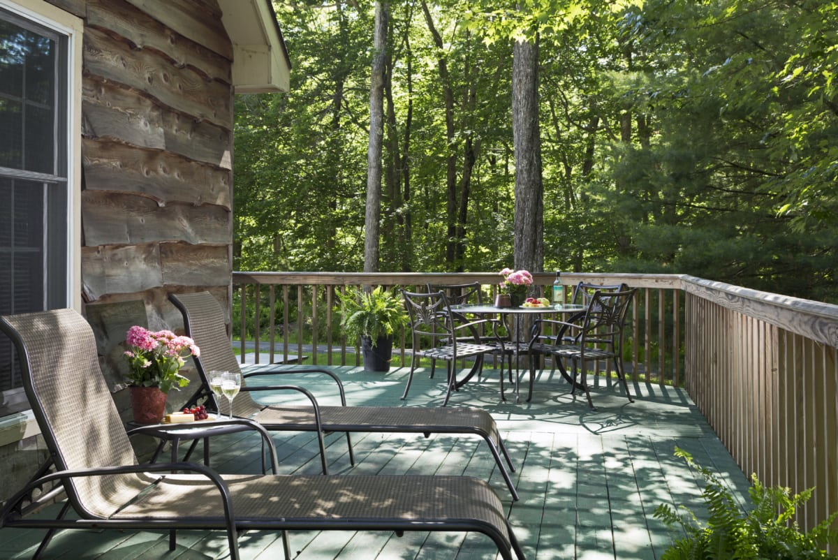 Eagle's Nest deck with two lounge chairs and a table and four chairs