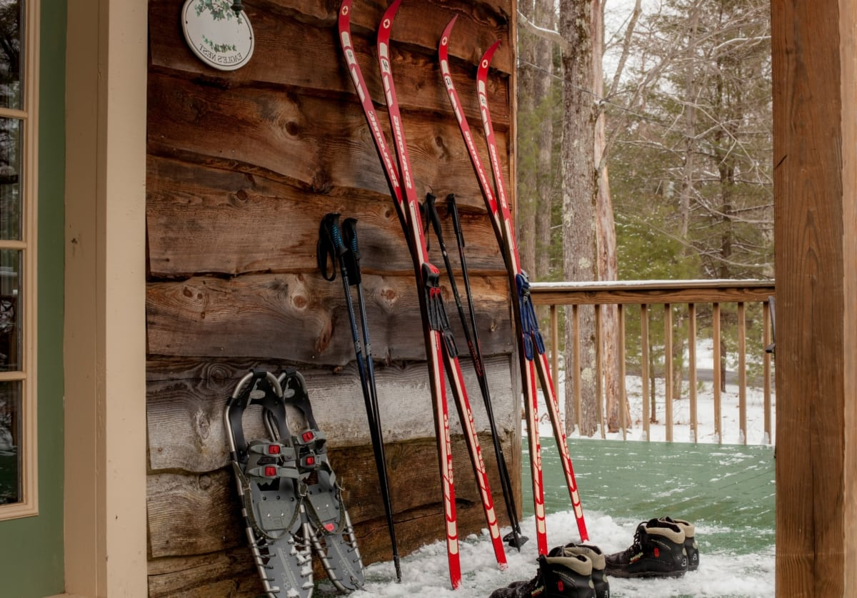 Skis and snowshoes against a wall