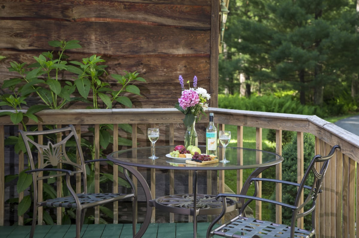 Gold level deck with a table and two chairs