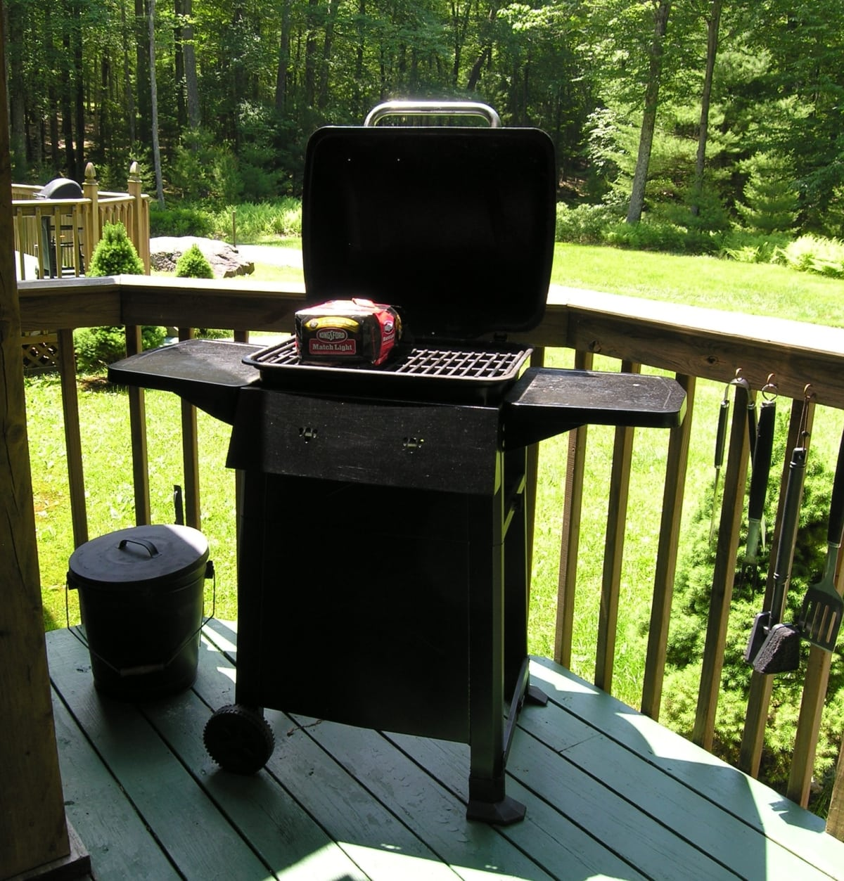 A grill on a deck