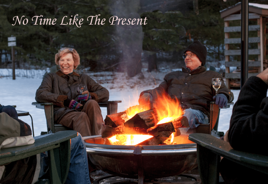 Rue and Ivan sitting at the firepit, overlaid with text: 'No Time Like the Present'