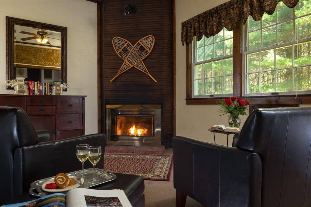 Fireplace with two rackets on the mantle