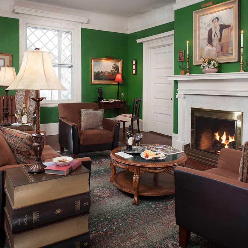 The living room with seating and fireplace