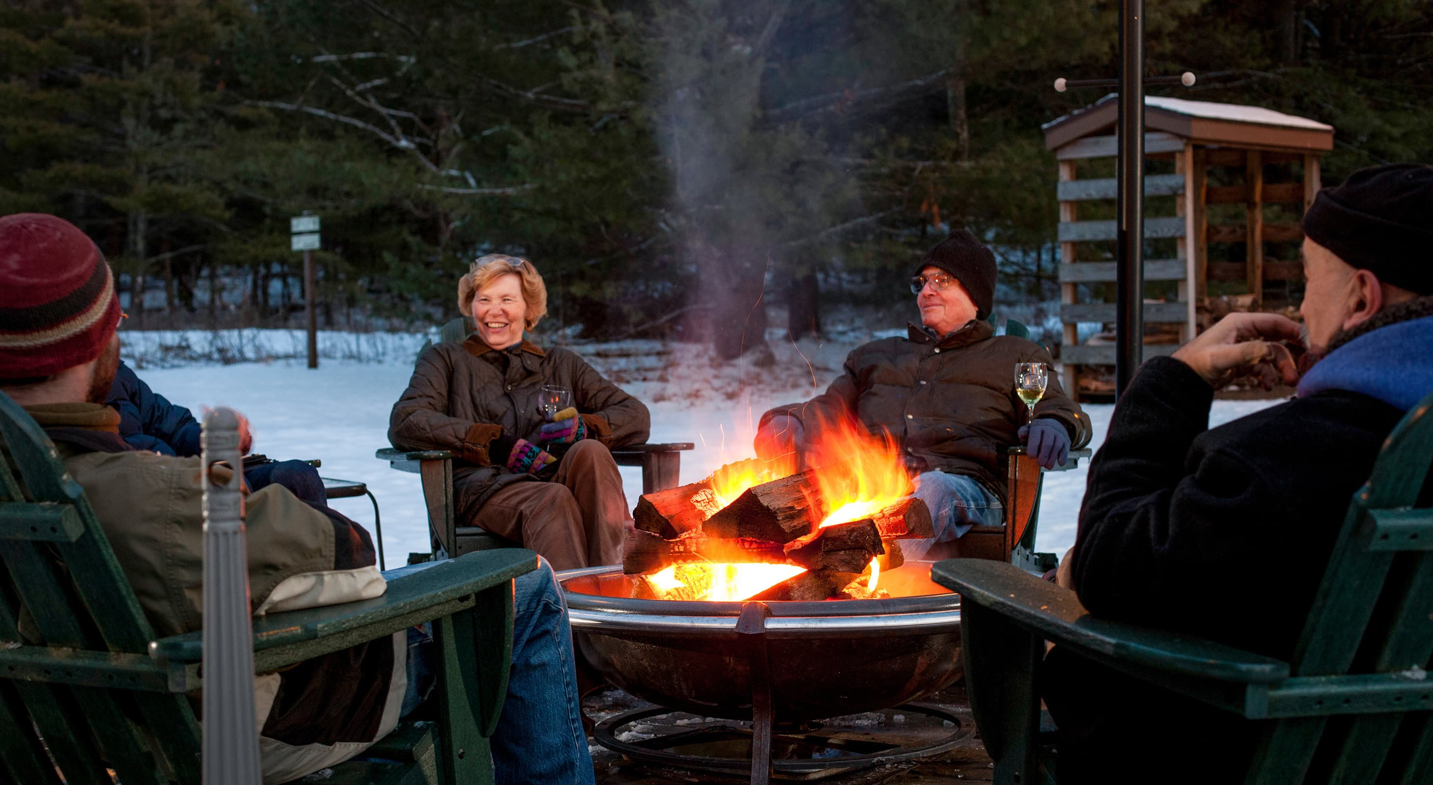 People sitting around our fire pit in winter