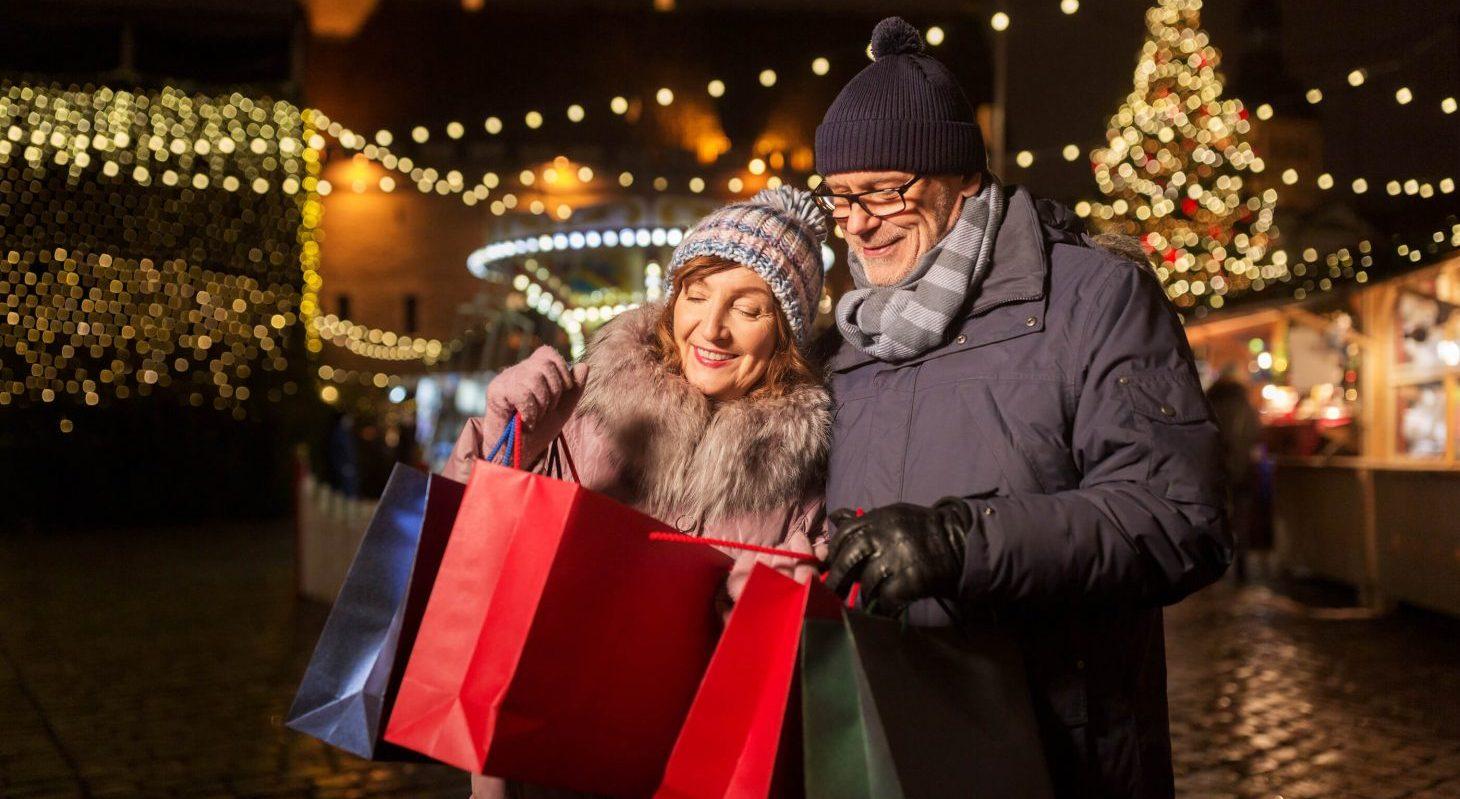 a couple christmas shopping at a market