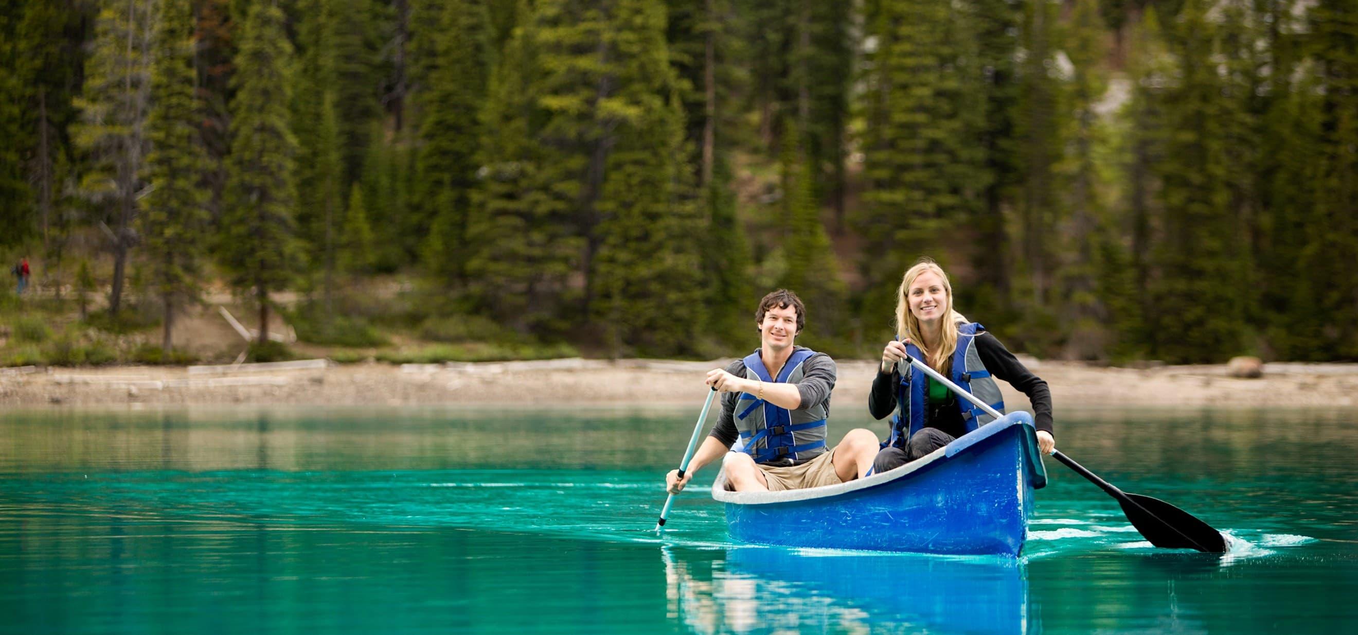 romantic couple rowing on lake