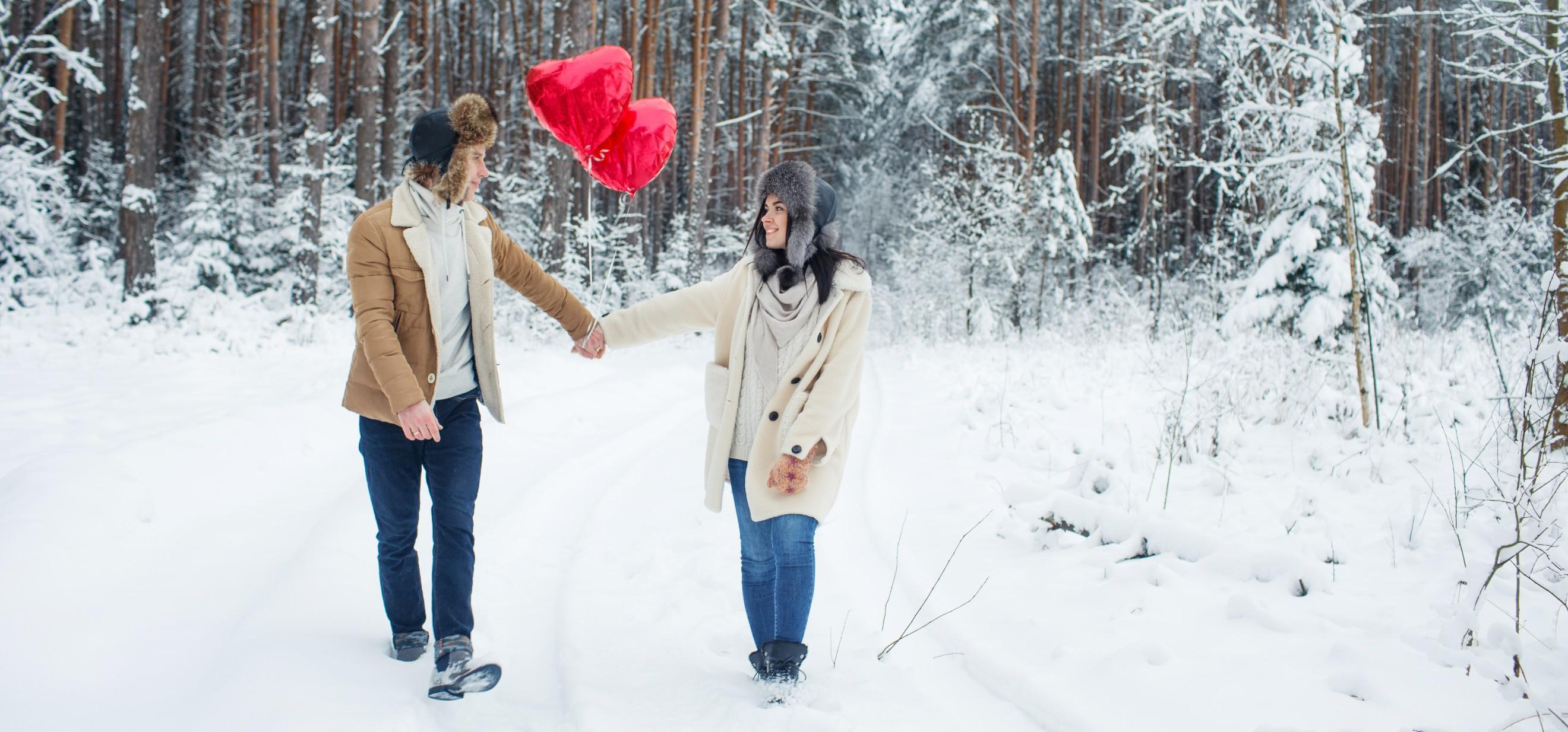 romantic couple strolling hand in hand in winter scene
